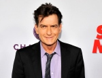 """FILE - In this April 11, 2013 file photo, Charlie Sheen, a cast member in """"Scary Movie V,"""" poses at the Los Angeles premiere of the film at the Cinerama Dome in Los Angeles. (Photo by Chris Pizzello/Invision/AP, file)"""