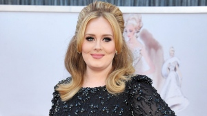 """In this Feb. 24, 2013 file photo, singer Adele arrives at the Oscars in Los Angeles. Adele released her new album, """"25,"""" on Friday, Nov. 20. (John Shearer/Invision/AP)"""