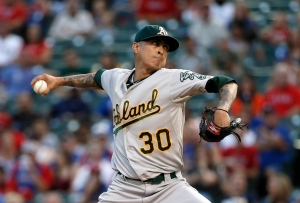 Oakland Athletics starting pitcher Jesse Chavez works against the Texas Rangers during the first inning of a baseball game Friday, Sept. 11, 2015, in Arlington, Texas. (AP Photo/Tony Gutierrez)
