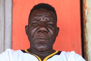 """In this Nov. 13, 2015 file photo, Zimbabwe's three-times Mr Ugly winner William Masvinu poses for a photo in Harare. Pageant judges have crowned a new winner of Zimbabwe's 4th annual """"Mister Ugly"""" contest, upsetting supporters of the crowd favorite and prompting rioting at the event. Judges on Saturday, Nov. 21 chose 42-year-old Milton Sere, citing his numerous missing front teeth and a wide range of grotesque facial expressions, over Masvinu, who had held the title since 2012. (AP Photo/Tsvangirayi Mukwazhi, File)"""