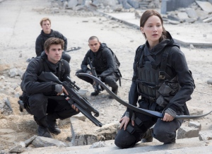 "This photo provided by Lionsgate shows, Liam Hemsworth, left, as Gale Hawthorne, Sam Clafin, back left, as Finnick Odair, Evan Ross, back right, as Messalia, and Jennifer Lawrence, right, as Katniss Everdeen, in the film, ""The Hunger Games: Mockingjay - Part 2."" (Murray Close/Lionsgate via AP)"