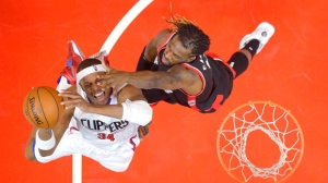 Los Angeles Clippers forward Paul Pierce, left, shoots as Toronto Raptors forward DeMarre Carroll defends during the first half of an NBA basketball game Sunday, Nov. 22, 2015, in Los Angeles. (AP Photo/Mark J. Terrill)