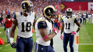 In this Oct. 4, 2015, file photo, St. Louis Rams wide receiver Stedman Bailey (12) celebrates his touchdown reception with teammates Kenny Britt (18) and Tavon Austin (11) during the second half of an NFL football game against the Arizona Cardinals in Glendale, Ariz. A person familiar with the situation told The Associated Press on condition of anonymity because details have not been released by the Rams, that Bailey was shot on Tuesday, Nov. 24. (AP Photo/Ross D. Franklin, File)