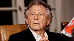 "In this Oct. 30, 2015 file photo filmmaker Roman Polanski tells reporters he can ""breath with relief"" after a Polish judge ruled that the law forbids his extradition to the U.S., where in 1977 he pleaded guilty to having sex with a minor, in Krakow, Poland. Poland will not extradite Oscar-winning filmmaker Roman Polanski to the U.S. in an almost 40-year-old case after prosecutors declined to challenge a court ruling against it. Prosecutors in Krakow, who sought the extradition on behalf of the U.S., said Friday they found the court's refusal of extradition to be ""right"" and said they found no grounds to appeal it. (AP Photo/Jarek Praszkiewicz, file)"