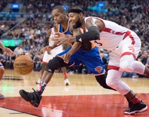Toronto Raptors forward James Johnson (3) and New York Knicks forward Lance Thomas battle for a loose ball during first half NBA action in Toronto on Tuesday, Nov. 10, 2015. (The Canadian Press/Frank Gunn)