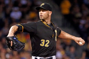 Pittsburgh Pirates starting pitcher J.A. Happ (32) delivers in the first inning of a baseball game against the St. Louis Cardinals, Monday, Sept. 28, 2015, in Pittsburgh. (AP Photo/Gene J. Puskar)