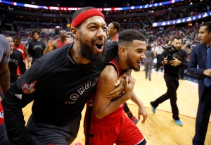 Toronto Raptors forward James Johnson, left, celebrates with guard Cory Joseph after an NBA basketball game against the Washington Wizards, Saturday, Nov. 28, 2015, in Washington. The Raptors won 84-82. (AP Photo/Alex Brandon)