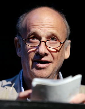 In this July 4, 2008 file photo the director Luc Bondy speaks to the audience in Zurich, Switzerland. Luc Bondy, a Swiss opera, theater and film director who staged productions on renowned stages across Europe and the United States, has died. He was 67. The Odeon Theatre in Paris, where Bondy last worked, said Saturday that he died of pneumonia. (Eddy Risch/Keystone via AP)