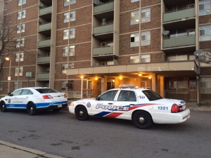 Police cruisers are shown outside an apartment building on Falstaff Avenue where a shooting took place on Sunday morning. (Arda Zakarian)