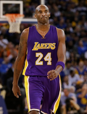 Los Angeles Lakers guard Kobe Bryant (24) walks on the floor during the second half of an NBA basketball game against the Golden State Warriors in Oakland, Calif., Tuesday, Nov. 24, 2015. The Warriors won 111-77. (AP Photo/Jeff Chiu)