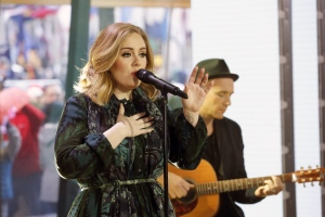 "In this image released by NBC, Adele performs on the ""Today"" show on Wednesday, Nov. 25, 2015, to promote her latest release, ""25."" (Heidi Gutman/NBC via AP)"
