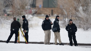Police investigators gather evidence near the scene of Friday's shooting at a Planned Parenthood clinic Sunday, Nov. 29, 2015, in northwest Colorado Springs, Colo. (AP Photo/David Zalubowski)