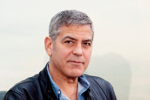 """FILE - In this Tuesday, May 19, 2015, file photo, U.S actor George Clooney attends a news conference of the film """"Tomorrow Land"""" at Ciudad de las Artes y las Ciencias in Valencia, Spain. Clooney will be a part of an all-star campaign being launched by Bono, featuring """"once-in-a-lifetime experiences"""" that can be won after donating at least $10 to Bono's organization (RED), which raises funds to fight AIDS. The campaign kicks off Tuesday, Dec. 1, 2015, to coincide with World AIDS Day, which is Dec. 1. (AP Photo/Abraham Caro Marin, File)"""
