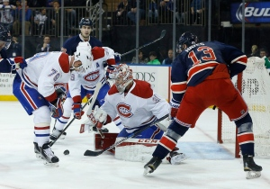 Montreal Canadiens goalie Carey Price (31) blocks a shot by New York Rangers right wing Kevin Hayes (13) as Canadiens defenceman Andrei Markov (79) looks for a rebound during the second period of an NHL hockey game, Wednesday, Nov. 25, 2015, in New York. (AP/Julie Jacobson)