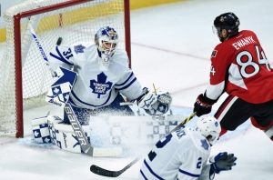 Toronto Maple Leafs' Garret Sparks, left, deflects a shot from Ottawa Senators' Travis Ewanyk during third period pre-season NHL hockey action in Ottawa on Monday, Sept. 21, 2015. (The Canadian Press/Sean Kilpatrick)