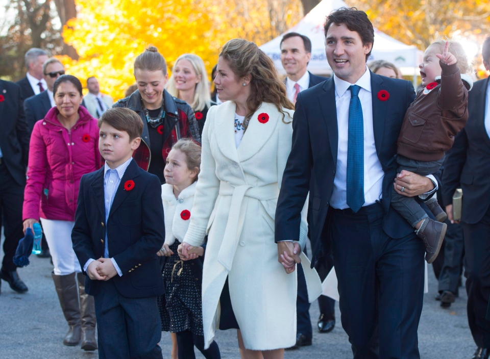 Marilou Trayvilla, one of two women employed to take care of the Trudeau children, is seen at left as she joins prime minister-designate Justin Trudeau and family upon their arrival to Rideau Hall for the swearing-in ceremony in Ottawa on Wednesday, Nov. 4, 2015. (The Canadian Press/Sean Kilpatrick)