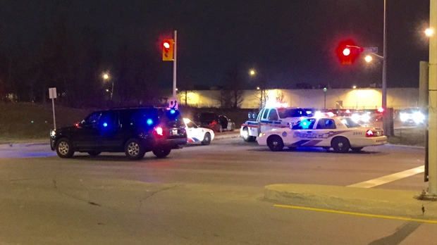 Various police vehicles can be seen near the intersection where a Mercedes sedan was found abandoned Friday morning. (Mike Nguyen/CP24)