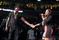 Meek Mill and Nicki Minaj hold hands during their performance at the Power 99 POWERHOUSE 2015 at the Wells Fargo Center on Friday, Oct. 23, 2015, in Philadelphia. (Photo by Owen Sweeney/Invision/AP)