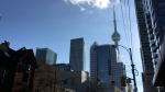 A cloud floats across the CN Tower in downtown Toronto on an unseasonably warm day Friday, December 11, 2015. (Joshua Freeman /CP24)