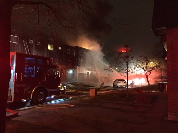 Crews are on the scene of a fire at a Brampton townhouse complex on Darras Court. (Tom Podolec/ CP24)