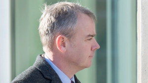 Dennis Oland heads to the Law Courts where he was found guilty of second degree murder in the death of his father, Richard Oland, in Saint John, N.B. on Saturday, Dec. 19, 2015. A professor of criminal justice history who has been following the Dennis Oland second-degree murder trial says he is shocked by the jury's guilty verdict. THE CANADIAN PRESS/Andrew Vaughan