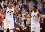 Toronto Raptors guards DeMar DeRozan (left) and Kyle Lowry congratulate each other in the dying seconds of a 103-99 win over the Dallas Mavericks in NBA action in Toronto on Tuesday, Dec. 22, 2015. (The Canadian Press/Frank Gunn)