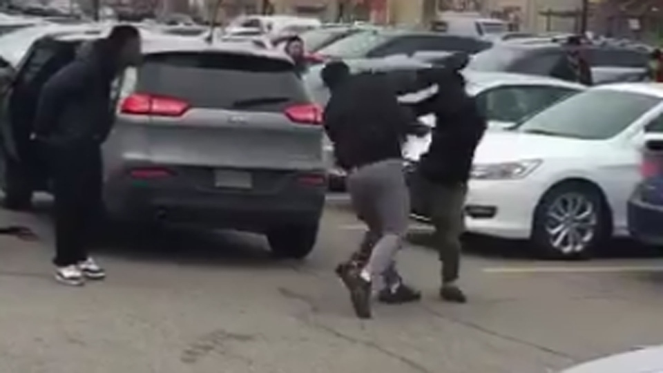 Men fight over a parking spot at Square One Shopping Centre in Mississauga Saturday December 26, 2015 in this screen grab from a video of the incident posted to Twitter.  (@WhoSFlyy__ /Twitter)