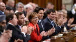 Prime Minister Justin Trudeau sits with members of his cabinet as they listen to the candidates vying for Speaker of the House of Commons deliver speeches prior to voting in the House of Commons on Parliament Hill in Ottawa on Thursday, Dec. 3, 2015. THE CANADIAN PRESS/Sean Kilpatrick