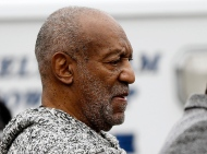 Bill Cosby leaves the Cheltenham Township Police Department where he was processed after being arraigned on a felony charge of aggravated indecent assault Wednesday, Dec. 30, 2015, in Elkins Park, Pa. Cosby was charged Wednesday with drugging and sexually assaulting a woman at his home in 2004. (AP Photo/Matt Rourke)