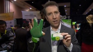 BNN's Michael Hainsworth shows off a glove at CES 2016 that can wirelessly control motors based on wrist movements. (BNN)