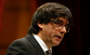 Incoming Catalan President Carles Puigdemont speaks during the investiture session at the Catalonian parliament in Barcelona, Spain, Sunday, Jan. 10, 2016. (Manu Fernandez / AP Photo)
