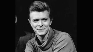 In this Sept. 17, 1980, file photo, David Bowie listens during a news conference after a rehearsal at the Booth Theater in New York. (AP /Marty Lederhandler, FIle)