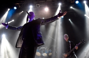 "Glenn Gregory, centre, and Tony Visconti, right, former producer for rock legend David Bowie, perform as part of the group Holy Holy, during a tribute concert playing covers from Bowie's 1970 album ""The Man Who Sold The World"" in its entirety, at Toronto's Opera House concert venue, on Tuesday, Jan. 12, 2016.. Bowie lost his battle with cancer early this week. THE CANADIAN PRESS/Nathan Denette"