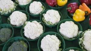 Cauliflowers, surrounded by broccoli and peppers, are seen at the Jean Talon Market, Monday, January 11, 2016 in Montreal. The soaring price of cauliflower is forcing restaurants offering signature dishes featuring the trendy vegetable to rethink menus and raise prices. THE CANADIAN PRESS/Paul Chiasson