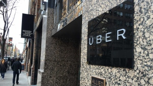 A man walks past Uber's office on Adelaide Street in downtown Toronto. (Joshua Freeman /CP24)