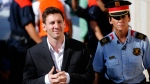 In this Sept. 27, 2013 file photo, FC Barcelona star Lionel Messi, left, arrives at a court to answer questions in a tax fraud case in Gava, near Barcelona, Spain. (AP Photo/Emilio Morenatti, File)