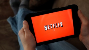 In this Friday, Jan. 17, 2014, file photo, a person displays Netflix on a tablet in North Andover, Mass. (Elise Amendola / AP)
