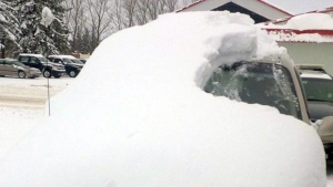 A snow-covered car is shown in a photo posted to Twitter by OPP on Tuesday, Jan. 19, 2016.