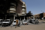 In this Sunday, Jan. 17, 2016 file photo, a soldier stands guard outside the Splendid Hotel in Ouagadougou, Burkina Faso after it was attacked by al-Qaida-linked extremists. (AP Photo/Sunday Alamba, File)
