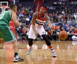 Washington Wizards guard Bradley Beal (3) passes the ball against Boston Celtics guard Avery Bradley (0) during the first half of an NBA basketball game, Monday, Jan. 25, 2016, in Washington. (AP Photo/Nick Wass)