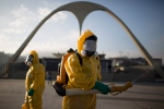 A health worker stands in the Sambadrome as he sprays insecticide to combat the Aedes aegypti mosquitoes that transmits the Zika virus in Rio de Janeiro, Brazil, Tuesday, Jan. 26, 2016. (AP Photo/Leo Correa)
