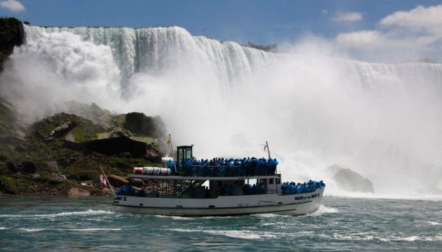 In this Friday, June 11, 2010 file photo, tourists ride the Maid of the Mist tour boat at the base of the American Falls in Niagara Falls, N.Y. (AP Photo/David Duprey)