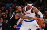 Phoenix Suns forward P.J. Tucker, left, tries to strip the ball from New York Knicks forward Carmelo Anthony during the first quarter of an NBA basketball game Friday, Jan. 29, 2016, in New York. (AP/Julie Jacobson)