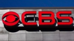 FILE - This Feb. 13, 2012, file photo, shows the CBS logo at the CBS Scene restaurant and bar at Gillette Stadium, in Foxborough, Mass. (AP Photo/Steven Senne, File)