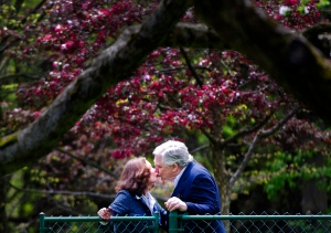Conrad Black, right, kisses his wife Barbara Amiel Black as he arrives at his Bridle Path residence in Toronto on Friday, May 4, 2012. (The Canadian Press/Nathan Denette)