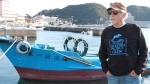 "In this Sept. 16, 2015 photo released by DolphinProject.com, Ric O'Barry stands at the Taiji Harbor in Taiji, Wakayama prefecture, western Japan. Japan has ordered the deportation of the star of the Oscar-winning documentary ""The Cove,"" about a dolphin-killing village in Japan. O'Barry was detained upon arrival Monday, Jan. 18, 2016 at Tokyo's Narita international airport. Japanese authorities decided Friday, Jan. 22 to turn down his appeal to get into the country, according to his son. (DolphinProject.com via AP)"