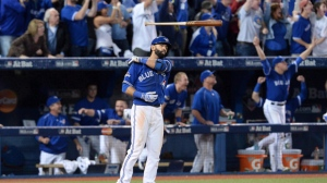 Toronto Blue Jays Jose Bautista flips his bat after hitting a three-run homer during seventh inning game 5 American League Division Series baseball action in Toronto on Wednesday, Oct. 14, 2015. Toronto slugger Bautista says he would like to be a Blue Jay for life. It appears to be up to the team's new front office to make the next move. THE CANADIAN PRESS/Chris Young