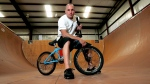 In a Friday, June 24, 2005 file photo, X-Games athlete Dave Mirra poses in the half-pipe at his training facility in Greenville, N.C. Police say veteran X Games biker Dave Mirra has died in North Carolina. Greenville police said Thursday, Feb. 4, 2016, that Mirra's body was found earlier in the day with an apparently self-inflicted gunshot wound.He was 41.  (AP Photo/Gerry Broome, File)