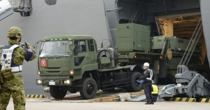 A vehicle carrying a PAC-3 missile interceptor arrives at a port on Ishigaki Island, Okinawa prefecture, southwestern Japan Saturday, Feb. 6, 2016. North Korea has moved up the window of its planned long-range rocket launch to Feb. 7-14, South Korea's Defense Ministry said Saturday. The launch, which the North says is an effort to send a satellite into orbit, would be in defiance of repeated warnings by outside governments who suspect it is a banned test of ballistic missile technology. (Koji Harada/Kyodo News via AP)