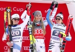 From left, second placed Switzerland's Fabienne Suter, first placed Lindsey Vonn, of the United States, and third placed Germany's Viktoria Rebensburg celebrate on the podium at the end of an alpine ski, women's World Cup downhill in Garmisch Partenkirchen, Germany, Saturday, Feb. 6, 2016. (AP Photo/Giovanni Auletta)
